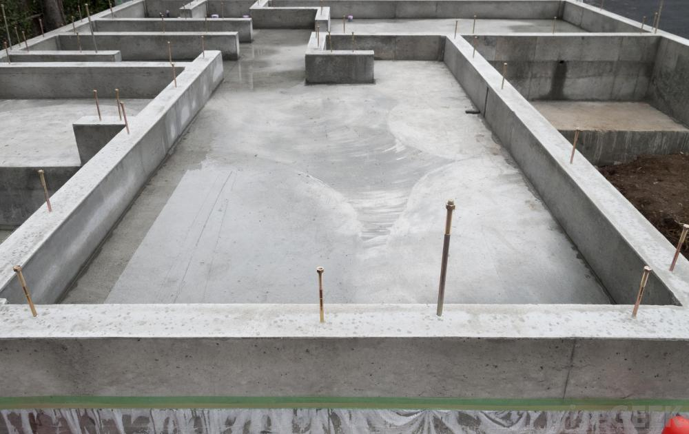 Concrete block foundation vs poured concrete foundation for Poured concrete basement walls